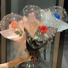 Four Transparent bobo balloons with roses inside and LED Light for anniversary celebration