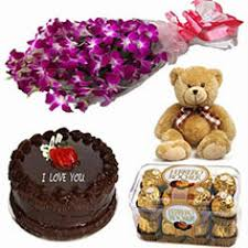 1/2 kg chocolate cake with teddy 6 orchids bouquet and 16 ferrero rocher