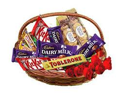 Cadburys mixed chocolates in a basket with 5 roses