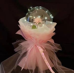 Clear transparent bubble with pink rose pink wrapping