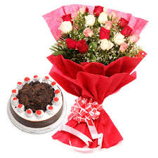 12 red roses with Half Kg black forest cake