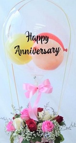 Happy anniversary transparent printed transparent balloon with 4 pink balloons and 20 pink roses arrangement