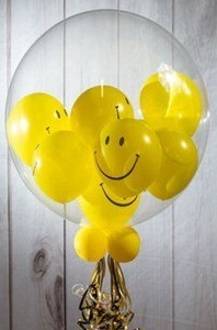 Emoji balloons inside clear bubble balloon