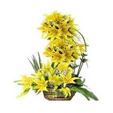 Shades of yellow lilies arrangement