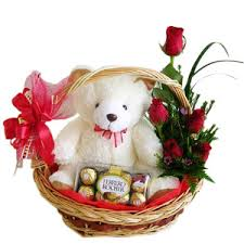 Basket of 12 red roses, teddy and 16 ferrero rocher chocolates