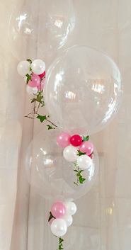 3 bubble balloons with trailing pink white red balloons