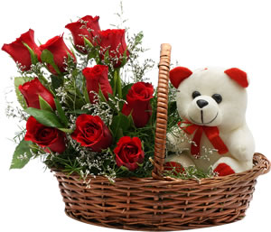 8 Red roses with 6 inches Teddy in a handle Basket