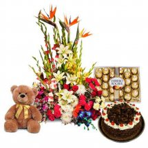 Large exotic flowers in a basket 24 Ferrero 1/2 Kg Black forest cake and 6 inches Teddy bear
