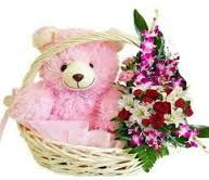 Basket of flowers with 1 foot teddy