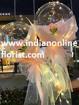 2 Pink rose in 2 transparent balloon arrangement with fairy light White wrapping