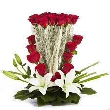 20 roses 4 white lilies basket