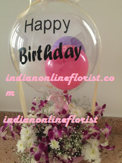 1 Clear transparent bubble bobo balloon with letter happy birthday Sticker stuffed with balloons and tied with ribbon to a basket of orchids and white flowers