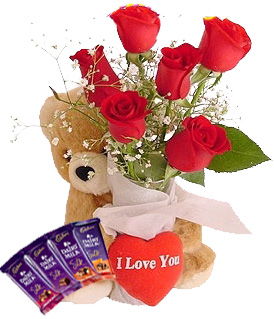 Teddy bear (6 inches ) and 6 Red roses 4 silk and Heart